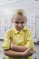 Angry little boy in a classroom