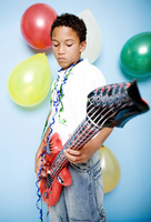 Boy playing with an inflatable guitar