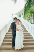 Bride and groom posing on stairway
