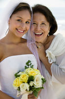 Bride and mother with flowers smiling  close-up   portrait