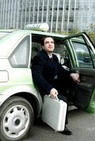 Popular : Businessman getting out from a taxi