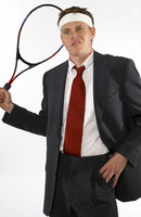 Businessman holding a tennis racquet