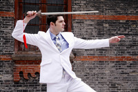 Businessman practicing kung fu with a chinese sword