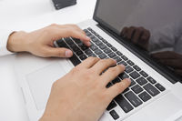 Businessman s hands using laptop