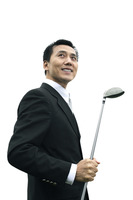 Popular : Businessman smiling while holding golf club