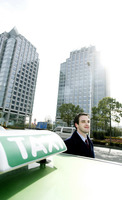 Popular : Businessman standing beside a taxi