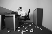 Popular : Businessman thinking  crumpled papers scattered on the floor