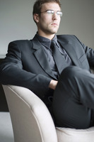 Popular : Businessman with glasses sitting on the couch thinking