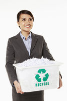 Popular : Businesswoman carrying a box filled with shredded paper