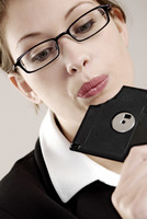 Popular : Businesswoman looking at a broken diskette