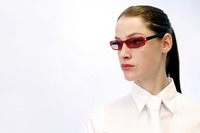 Businesswoman wearing a red funky sunglass