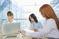 Businesswomen working at table in office