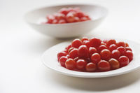 Cherry tomatoes on plate and bowl