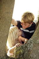 Children climbing up a tree