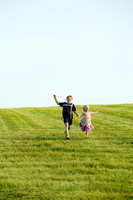 Children running at a field