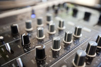 Close up of knobs on audio console
