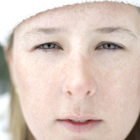 Close-up of woman in white knitted hat