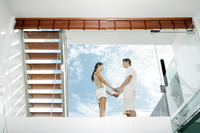 Couple holding hands on the balcony