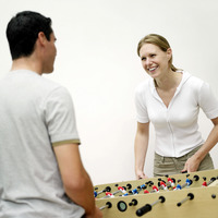 Couple playing foosball together