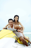 Couple riding on jet ski