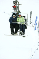 Couple traveling on chair lift