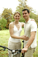 Popular : Couple with their bicycle in the park