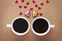 Cup of coffees with heart shapes chocolates