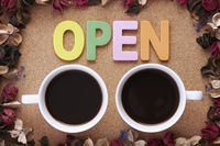 Cup of coffees with open letters