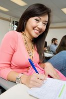 Female student taking notes during class  portrait
