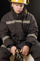 Popular : Fire fighter holding protective gloves