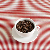 Popular : Fresh espresso coffee beans in a cappuccino cup