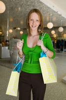 Girl holding shopping bags in boutique portrait