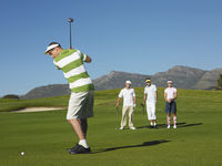 Popular : Golfer teeing off