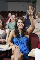Group of people in classroom one woman with raised arm
