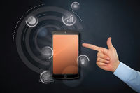 Hand pointing at business icons and mobile phone