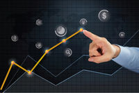 Hand pointing towards business idea point on line chart concept