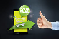 Hand showing thumbs up at cyber monday sale concept