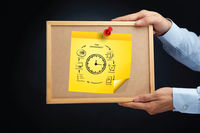 Hands holding a board with time management concept