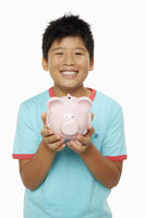 Happy boy with a piggy bank