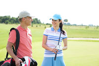 Popular : Happy male and female golfers communicating at course