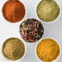 High angle view of five bowls of spices