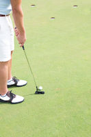 Popular : Low section of mid-adult man playing golf