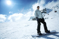 Male snowboarder posing for the camera