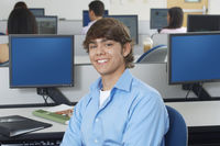 Male student sitting in computer classroom portrait