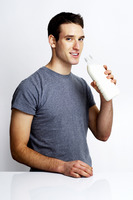 Man holding a bottle of milk