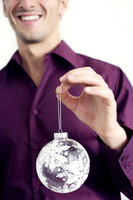Man holding a christmas ornament