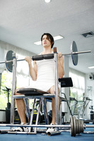 Man lifting barbell in the gym