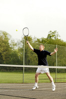 Man playing tennis in the tennis court