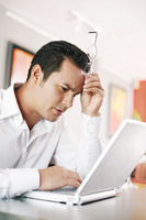 Popular : Man resting his head while using laptop