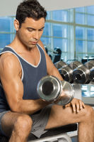 Popular : Man using dumbbell in gymnasium